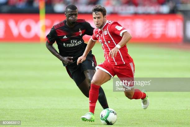 Juan Bernat of FC Bayern Muenchen in action against MÕBaye Niang of AC Milan during the 2017 International Champions Cup football match between AC...