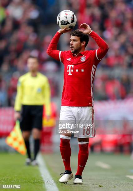 Juan Bernat of FC Bayern Muenchen takes the throwin during the Bundesliga match between Bayern Muenchen and FC Schalke 04 at Allianz Arena on...