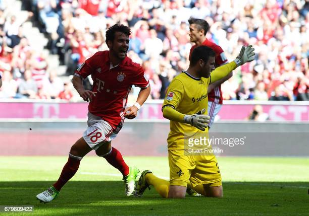 Juan Bernat of Muenchen celebrates scoring the first goal during the Bundesliga match between Bayern Muenchen and SV Darmstadt 98 at Allianz Arena on...