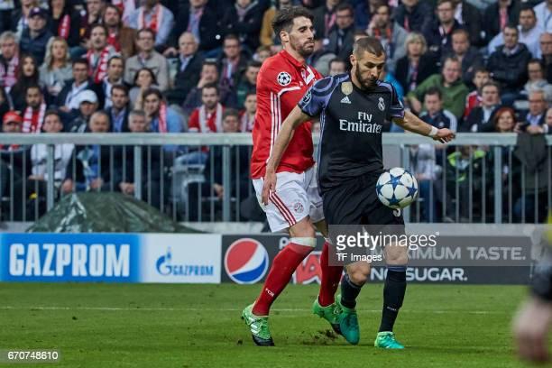 Juan Bernat of Munich and Karim Benzema of Real Madrid battle for the ball during the UEFA Champions League Quarter Final first leg match between FC...