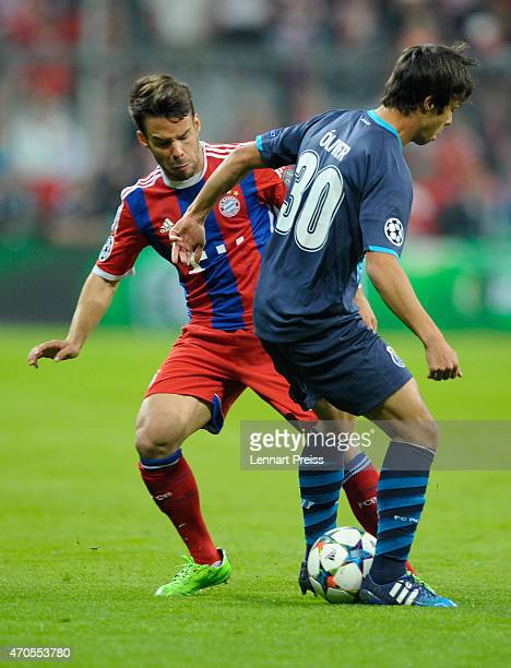 Juan Bernat of Munich challenges Oliver Torres of Porto during the UEFA Champions League quarter final second leg match between FC Bayern Muenchen...