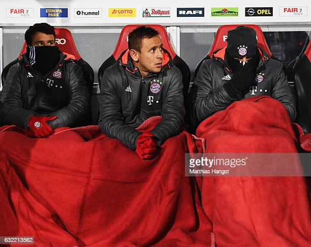 Juan Bernat Rafinha and Franck Ribery of Muenchen stay warm on the substitutes bench during the Bundesliga match between SC Freiburg and Bayern...