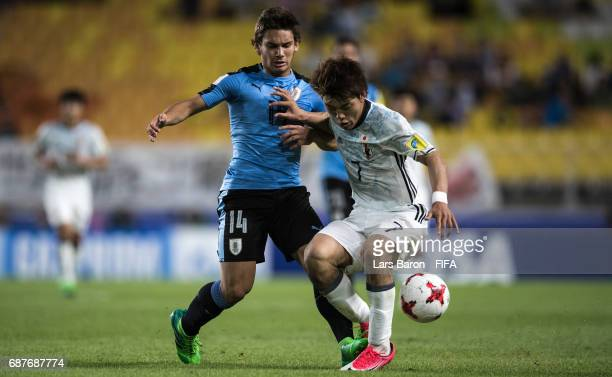 Juan Boselli of Uruguay challenges Ritsu Doan of Japan during the FIFA U20 World Cup Korea Republic 2017 group D match between Uruguay and Japan at...