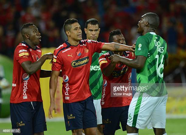 Juan Caicedo and Hernan Pertuz of Independiente Medellin argue with German Mera of Deportivo Cali during a match between Medellin and Deportivo Cali...
