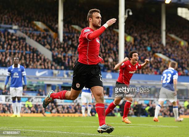 Juan Cala of Cardiff City celebrates scores his team's first goal during the Barclays Premier League match between Everton and Cardiff City at...