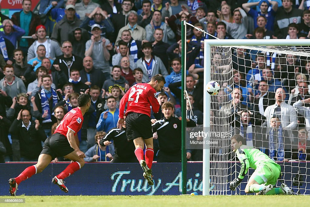 Juan Cala (C) of Cardiff City heads past goalkeeper <a gi-track='captionPersonalityLinkClicked' href=/galleries/search?phrase=Asmir+Begovic&family=editorial&specificpeople=4184467 ng-click='$event.stopPropagation()'>Asmir Begovic</a> of Stoke City only for the goal to be disallowed during the Barclays Premier League match between Cardiff City and Stoke City at the Cardiff City Stadium on April 19, 2014 in Cardiff, Wales.
