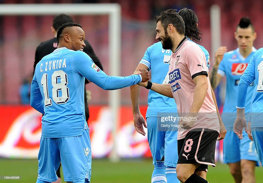 Juan Camilo Zuniga of Napoli (L) and Andrea Dossena of Palermo shake hands during the Serie A match between SSC Napoli and US Citta di Palermo at Stadio San Paolo on January 13, 2013 in Naples, Italy.