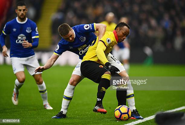 Juan Camilo Zuniga of Watford and James McCarthy of Everton battle for the ball during the Premier League match between Watford and Everton at...