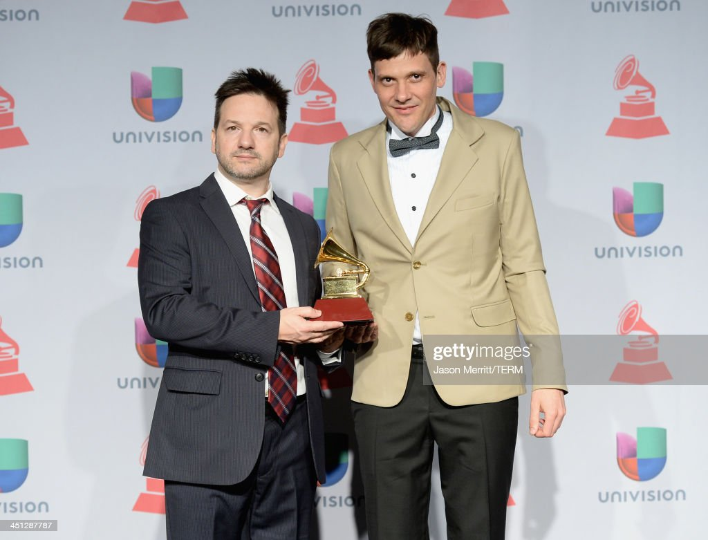 Juan Campodnico (R) of Bajofondo poses with Best Alternative Song award in the press room at the 14th Annual Latin GRAMMY Awards held at the Mandalay Bay Events Center on November 21, 2013 in Las Vegas, Nevada.