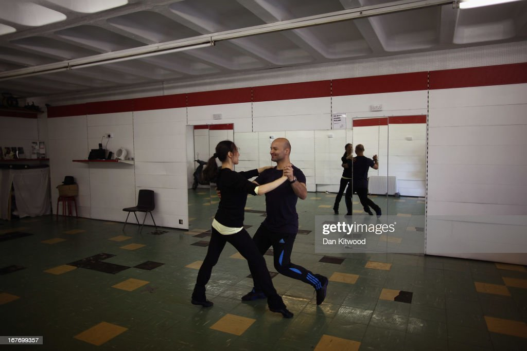 Juan Carlos (right) and Nadia Romero take part in a latin dance class behind a shutter in an abandoned shop in the Heygate Estate in the Walworth area on April 24, 2013 in London, England. The Heygate estate in central London was built in 1974 as social housing and housed around 3000 people, but fell into a state of disrepair, gaining a reputation for crime and poverty. The estate is due to be demolished as part of the £1.5billion GBP 'Elephant & Castle regeneration scheme', and replaced with 2,500 'affordable' new homes. The area has become popular with street artists, storytellers, and guerilla gardeners and attracts an array of urban wildlife including bats, birds and mammals.