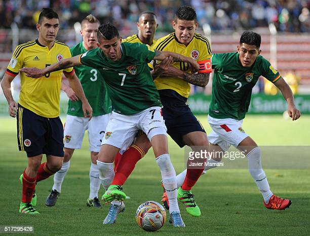 Juan Carlos Arce of Bolivia and James Rodriguez of Colombia fight for the ball during a match between Bolivia and Colombia as part of FIFA 2018 World...