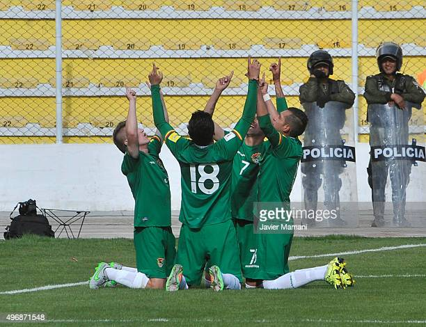 Juan Carlos Arce of Bolivia celebrates with teammates after scoring the second goal of his team during a match between Bolivia and Venezuela as part...