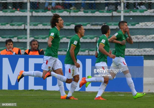 Juan Carlos Arce of Bolivia celebrates with teammates after scoring the first goal of his team during a match between Bolivia and Chile as part of...
