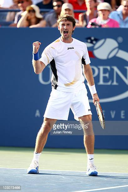 Juan Carlos Ferrero of Spain celebrates winning the match against Gael Monfils of France during Day Four of the 2011 US Open at the USTA Billie Jean...