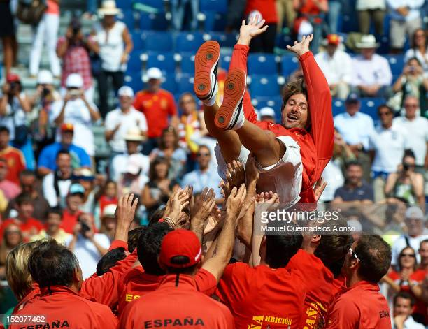 Juan Carlos Ferrero of Spain celebrates with his teammates after their victory over the United States on day three of the semi final Davis Cup...