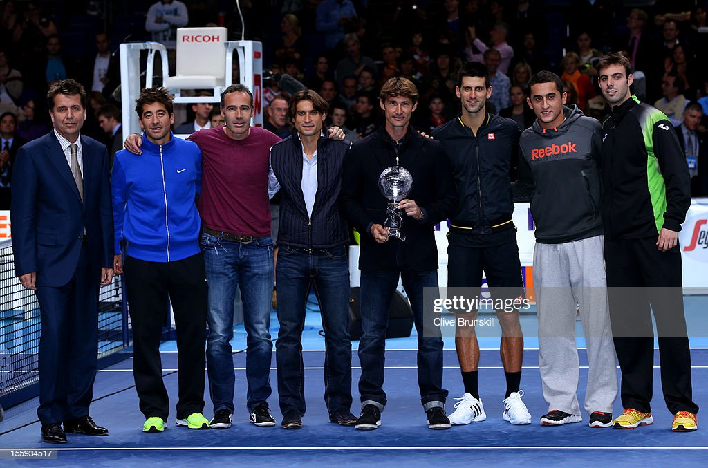 Juan Carlos Ferrero of Spain poses next to ATP Executive Chairman and President Brad Drewett Marc Lopez of Spain Alex Corretja David Ferrer of Spain...