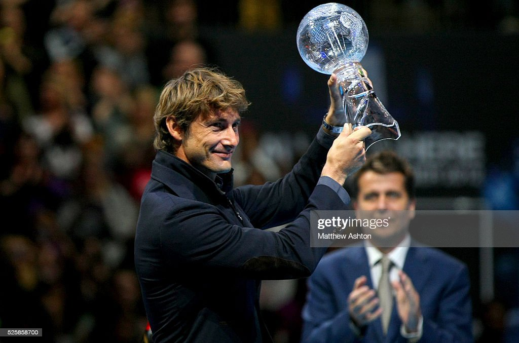 Juan Carlos Ferrero receives his retirement award from Brad Drewett ATP Director at the ATP World Tour Finals O2 Arena 2012