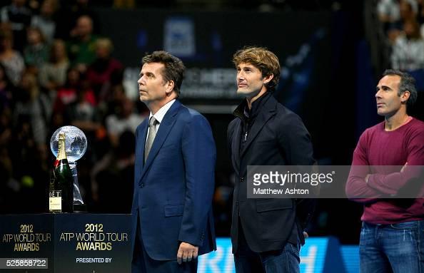 Juan Carlos Ferrero receives his retirement award from Brad Drewett ATP Director at the ATP World Tour Finals O2 Arena 2012