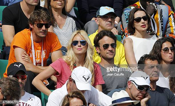 Juan Carlos Ferrerro Carlos Moya and his wife Carolina Cerezuela Luz Casal attend day 11 of the French Open 2015 at Roland Garros stadium on June 3...