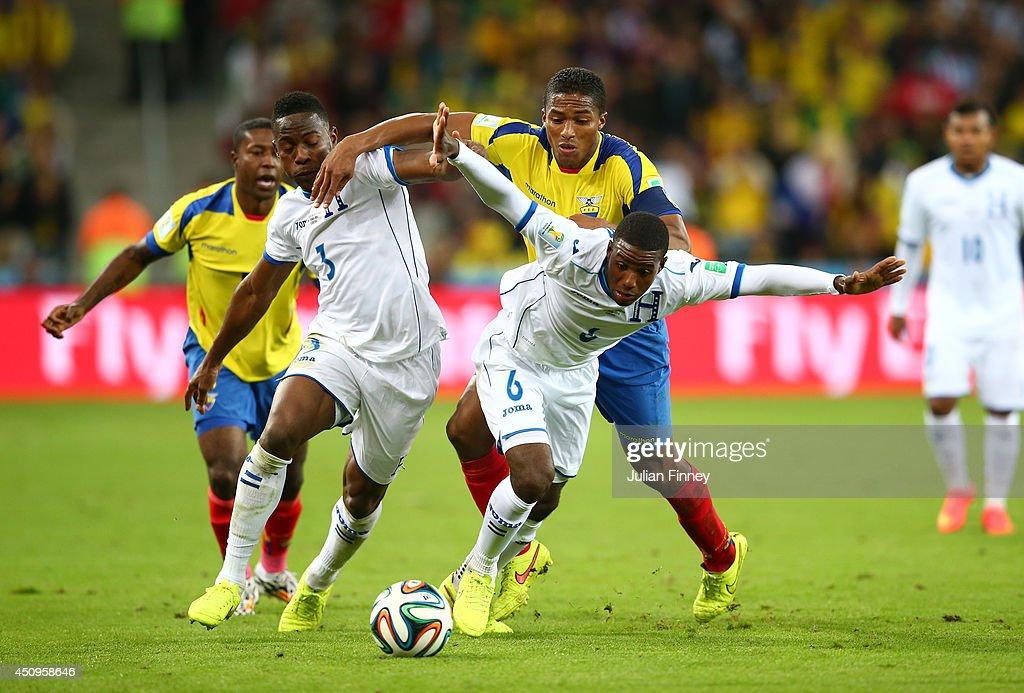 Juan Carlos Garcia of Honduras controls the ball past Antonio Valencia of Ecuador during the 2014 FIFA World Cup Brazil Group E match between Honduras and Ecuador at Arena da Baixada on June 20, 2014 in Curitiba, Brazil.