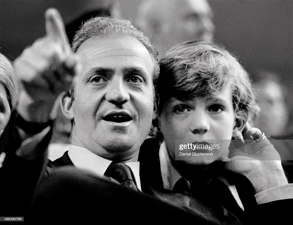 Juan Carlos, King of Spain, and his son the Prince Felipe watch a tennis match in Madrid, Spain in 1977. King Juan Carlos of Spain has renounced the throne after 39 years and will be succeeded by his son Prince Felipe of Spain.