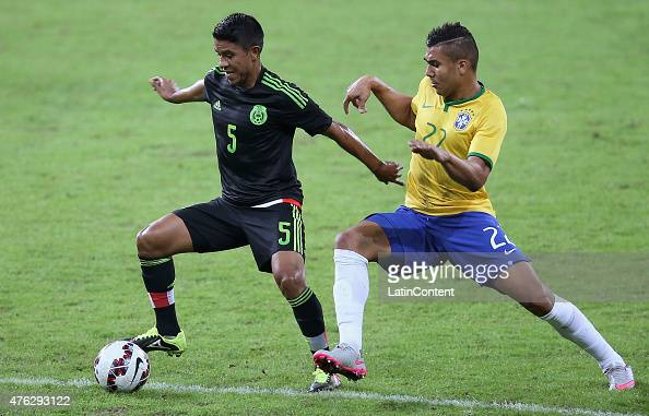 Juan Carlos Medina of Mexico fights for the ball with Casemiro of Brazil during a friendly match between Brazil and Mexico at Allianz Parque Stadium...
