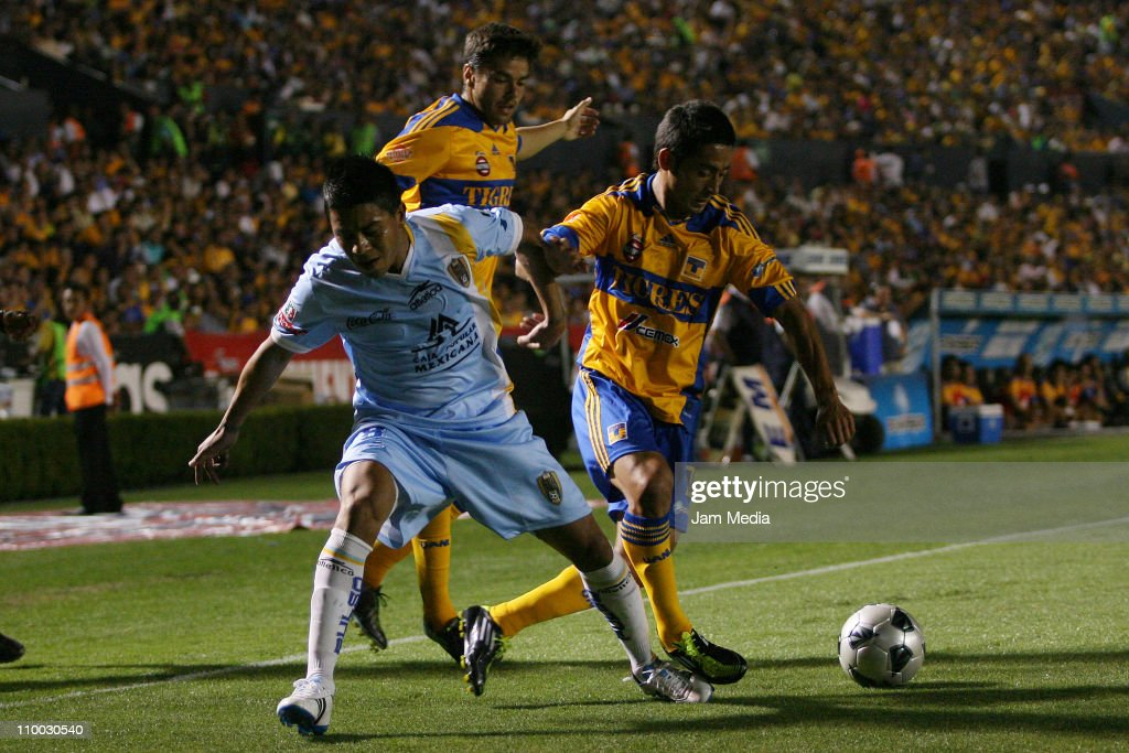 Juan Carlos Medina (L) of San Luis struggles for the ball with David Toledo (L) and Anselmo Vendrechovski (C) of Tigres during a match as part of the Clausura 2011 Tournament in the Mexican Football League at Universitary Stadium on March 12, 2011 in Monterrey, Mexico.