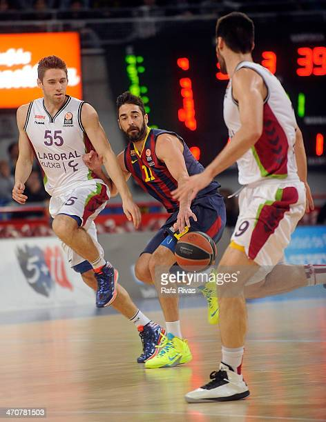 Juan Carlos Navarro #11 of FC Barcelona competes with Fabien Causeur #55 of Laboral Kutxa Vitoria during the 20132014 Turkish Airlines Euroleague Top...