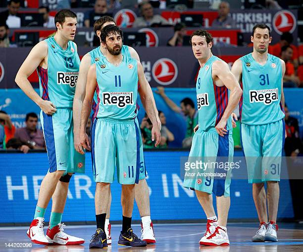 Juan Carlos Navarro #11 of FC Barcelona Regal and his team mates look dejected during the Turkish Airlines EuroLeague Final Four Semi Final match...