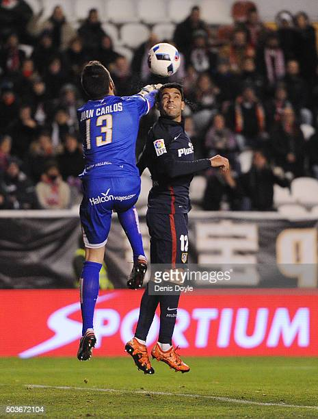 Juan Carlos of Rayo Vallecano de Madrid clears the ball from Augusto Fernandez of Club Atletico de Madrid during the Copa del Rey Round of 16 First...