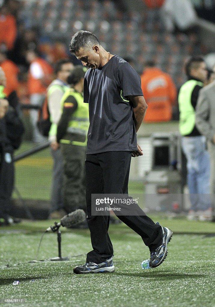 Juan Carlos Osorio coach of Atletico Nacional walks on the sideline during a quarterfinal match between Atletico Nacional and Defensor Sporting as part of Copa Bridgestone Libertadores 2014 at Atanasio Girardot Stadium on May 08, 2014 in Medellin, Colombia.