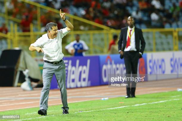 Juan Carlos Osorio coach of Mexico gives instructions to his players during the fifth round match between Trinidad Tobago and Mexico as part of the...
