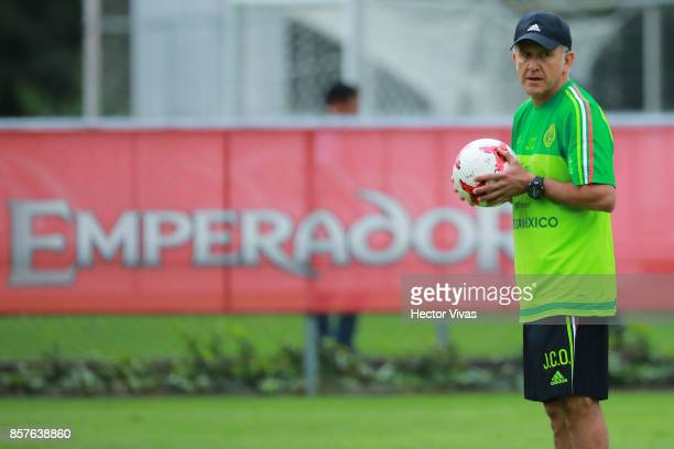 Juan Carlos Osorio coach of Mexico looks on during a Mexico's National Team training session ahead of the Qualifier match against Trinidad Tobago at...
