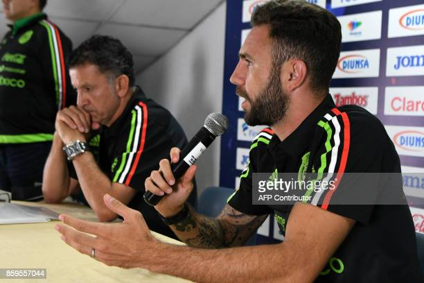 Juan Carlos Osorio the coach of Mexico's national football team and Mexican footballer Miguel Layun answer questions from the press in San Pedro Sula...