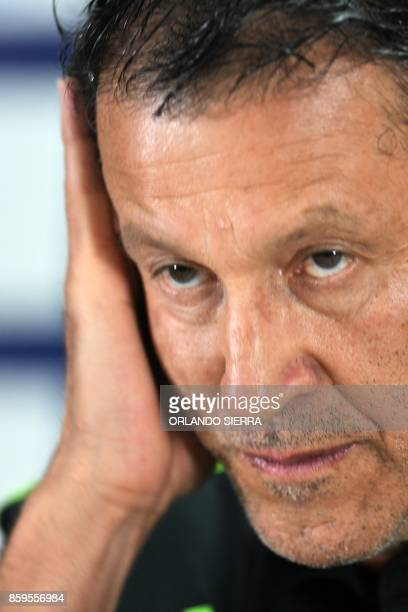 Juan Carlos Osorio the coach of Mexico's national football team gestures as he answers questions from the press in San Pedro Sula 180 km north of...