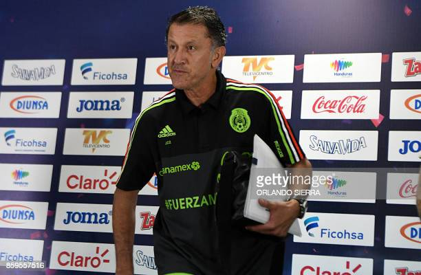 Juan Carlos Osorio the coach of Mexico's national football team gets ready to take part in a press conference in San Pedro Sula 180 km north of...