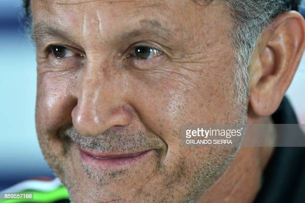 Juan Carlos Osorio the coach of Mexico's national football team smiles as he answers questions from the press in San Pedro Sula 180 km north of...