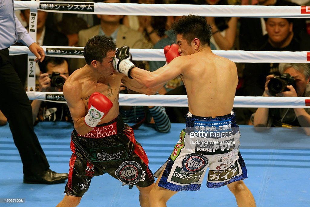 Juan Carlos Reveco(L) of Argentina and <a gi-track='captionPersonalityLinkClicked' href=/galleries/search?phrase=Kazuto+Ioka&family=editorial&specificpeople=7488576 ng-click='$event.stopPropagation()'>Kazuto Ioka</a> of Japan exchange punches during the WBA World Flyweight Title Bout at the Osaka Prefectural Gymnasium on April 22, 2015 in Osaka, Japan.