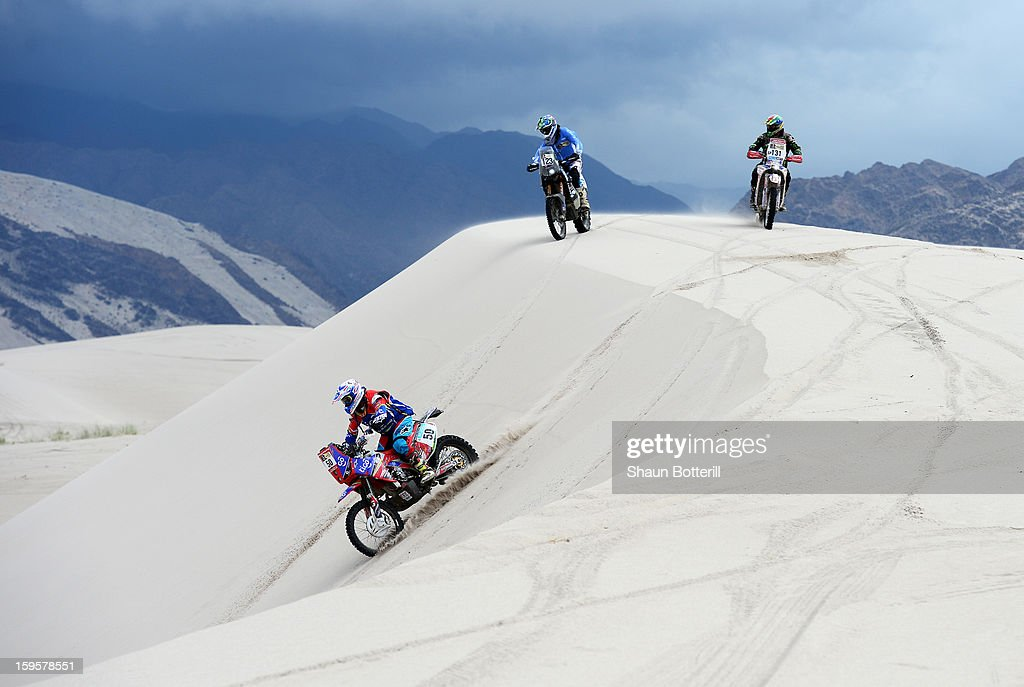 Juan Carlos Salvatierra (50), Rodney Faggotter (123) and Warren Strange compete in stage 11 from La Rioja to Fiambala during the 2013 Dakar Rally on Janary 16 in Lau Rioja, Argentina.