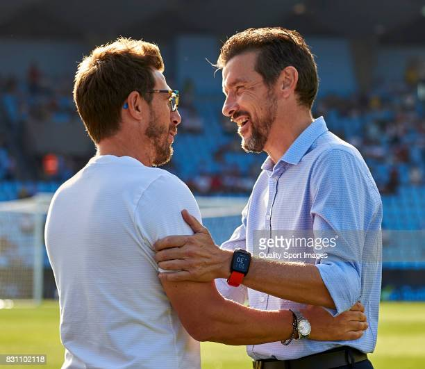 Juan Carlos Unzue the manager of Celta de Vigo tlaks with with Eusebio Di Francesco the manager of AS Roma prior to the preseason friendly match...
