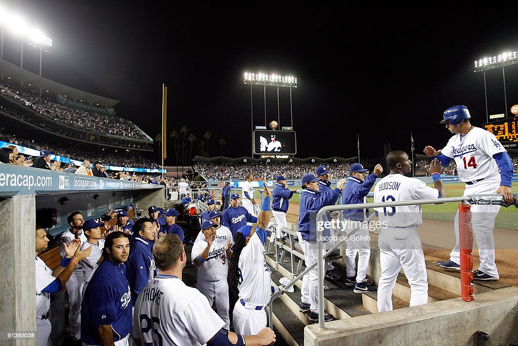 <a gi-track='captionPersonalityLinkClicked' href=/galleries/search?phrase=Juan+Castro&family=editorial&specificpeople=210684 ng-click='$event.stopPropagation()'>Juan Castro</a> #14 of the Los Angeles Dodgers celebrates with the team after getting a run in the seventh inning against the Colorado Rockies to win the National Leauge West on October 3, 2009 in Los Angeles, California.