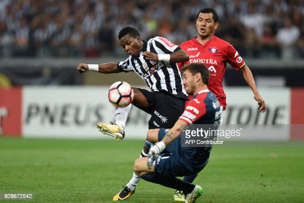 Juan Cazares of Brazil's Atletico Mineiro vies for the ball with Raul Olivares of Bolivia's Jorge Wilstermann during their 2017 Copa Libertadores...