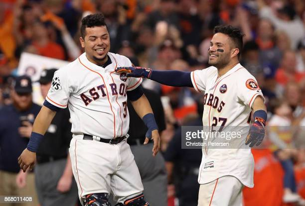 Juan Centeno and Jose Altuve of the Houston Astros celebrate after defeating the Los Angeles Dodgers in game five of the 2017 World Series at Minute...