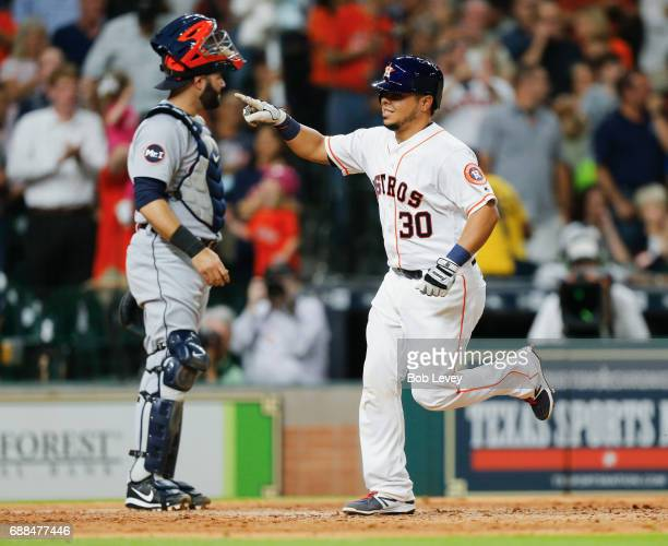 Juan Centeno of the Houston Astros hits a home run in the fourth inning against the Detroit Tigers at Minute Maid Park on May 25 2017 in Houston Texas
