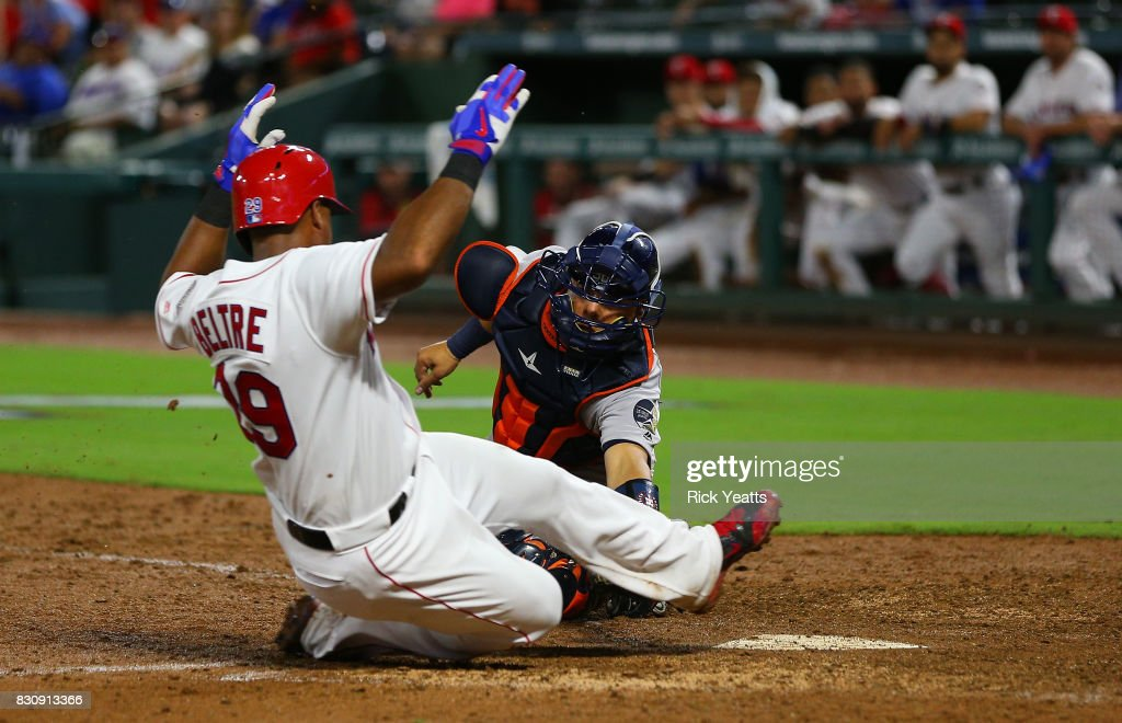 Juan Centeno #30 of the Houston Astros tags out Adrian Beltre #29 of the Texas Rangers in the fifth inning at home at Globe Life Park in Arlington on August 12, 2017 in Arlington, Texas.