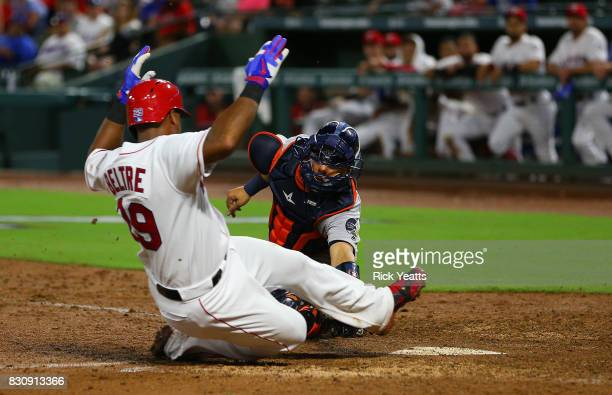 Juan Centeno of the Houston Astros tags out Adrian Beltre of the Texas Rangers in the fifth inning at home at Globe Life Park in Arlington on August...