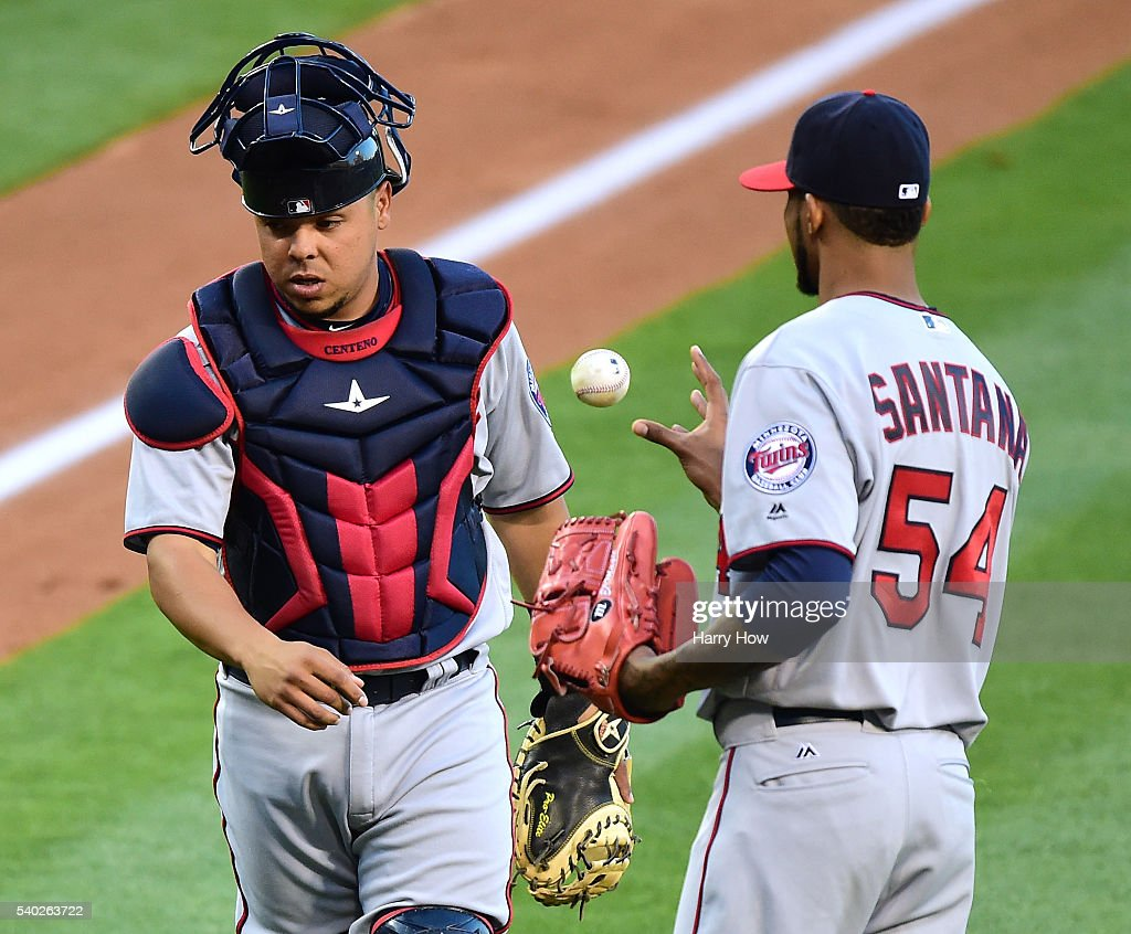 Juan Centeno #37 of the Minnesota Twins and Ervin Santana #54 react after a single by Albert Pujols #5 of the Los Angeles Angels to score Yunel Escobar #6 to take a 1-0 lead during the first inning at Angel Stadium of Anaheim on June 14, 2016 in Anaheim, California.