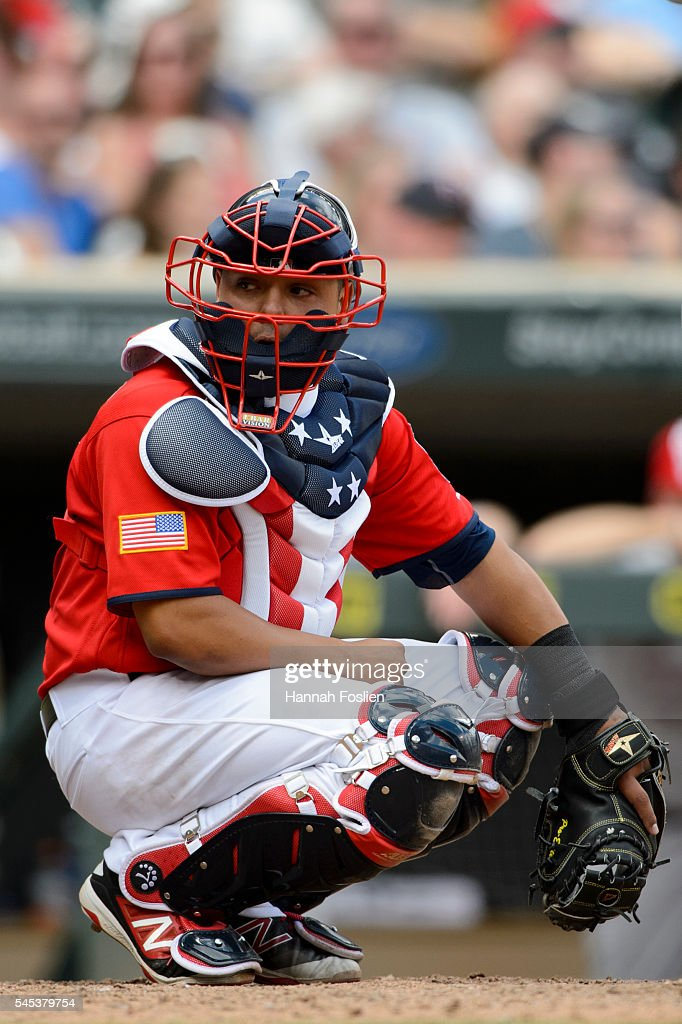 Juan Centeno of the Minnesota Twins looks on while wearing a special chest protector for the 4th of July during the game against the Oakland...