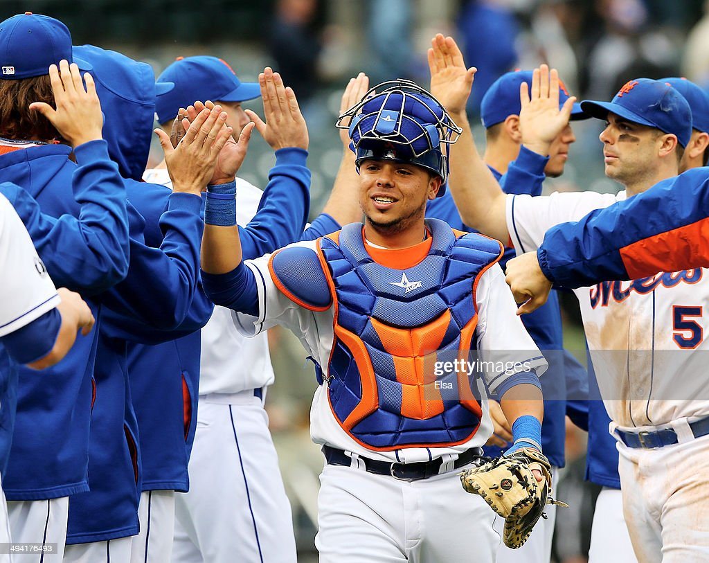 Juan Centeno #36 of the New York Mets celebrates the 5-0 win over the Pittsburgh Pirates with teammates after the game on May 28, 2014 at Citi Field in the Flushing neighborhood of the Queens borough of New York City.