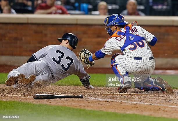 Juan Centeno of the New York Mets tags out Kelly Johnson of the New York Yankees at home plate on a Derek Jeter ground ball to shortstop in the...
